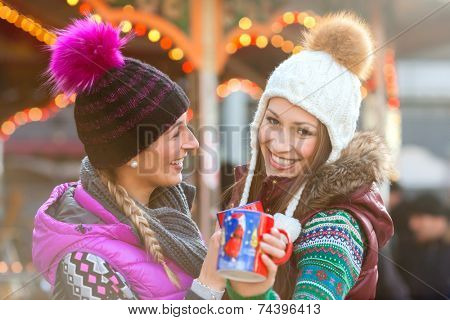 Friends drinking eggnog on Christmas Market
