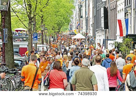 AMSTERDAM - APRIL 26: Streets of Amsterdam full of people in orange during the celebration of kings day on April 26, 2014 in Amsterdam, The Netherlands