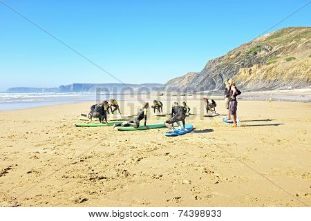 VALE FIGUEIRAS, PORTUGAL - July 21 2014: Surfers doing excersises on the famous surfers beach Vale Figueiras in Portugal