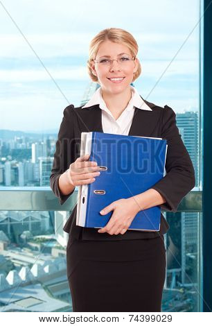 Business woman with folder in the office