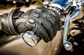pic of motorcycle  - Human hand in a Motorcycle Racing Gloves holds a motorcycle throttle control - JPG