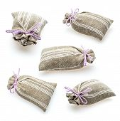 image of sachets  - Textile sachet pouch with dried lavender flowers isolated on white - JPG