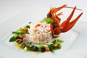 picture of cooked blue crab  - Risotto with crab and vegetables sauce on white plate - JPG