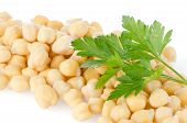 stock photo of chickpea  - Closeup of pile of chickpeas against white background