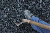 stock photo of power-shovel  - Miner working at shoveling load coal mine - JPG