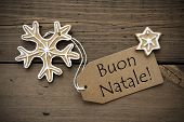 picture of ginger bread  - The Italian Words Buon Natale which means Merry Christmas on a Label with some Ginger Breads on Wood - JPG