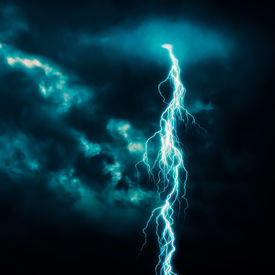 picture of lightning-rod  - A dark blue cloudy sky with lightning  - JPG