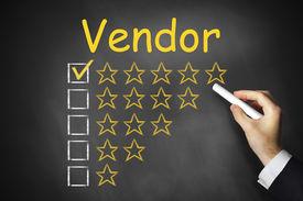 stock photo of payment methods  - hand writing vendor on black chalkboard golden star rating - JPG