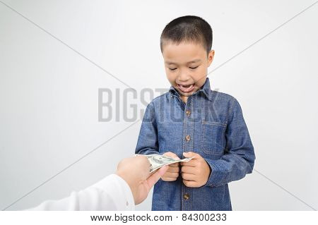 Young Boy Receive American Bank Note From Hand
