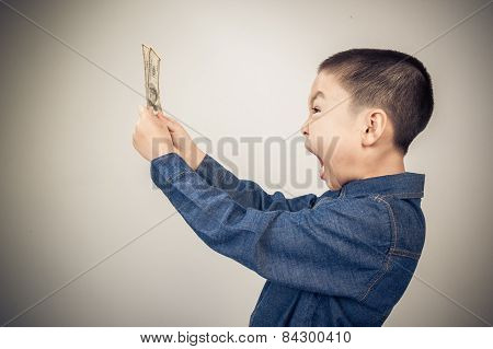 Young Boy Excite With  American Dollar Bank Note