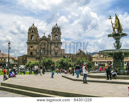 People Relax At At Central Square Plaza De Armas In Cuzco, Peru.