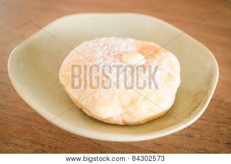 Cream Donut On Vintage Background
