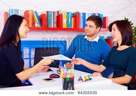 Satisfied Clients During Business Negotiations In Office