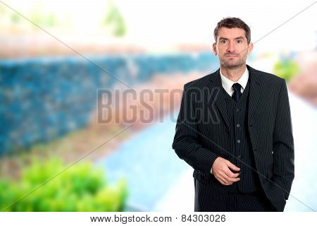 Businessman In Front Of Outside- Background