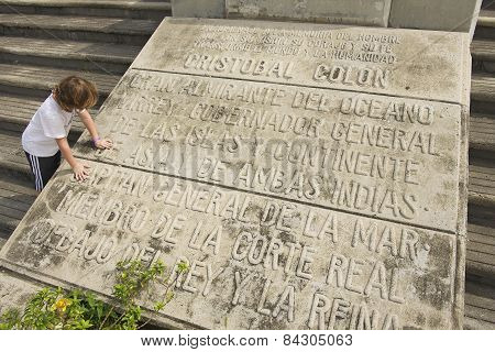 Kid reads the Memorial plaque at the entrance to the Columbus Lighthouse in Santo Domingo.