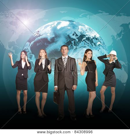 Business people in suits standing on background of Earth.