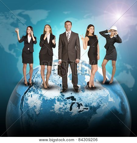Business people in suits standing on Earth