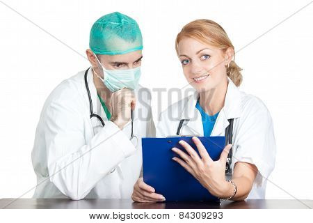 Two Doctors Discussing About Medical Report