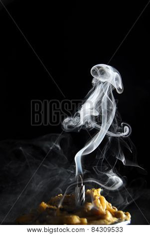 White Candle Smoke At Dark Background