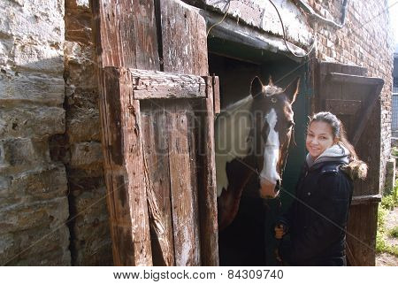 Teenage Girl With Her Beautiful Horse Friend