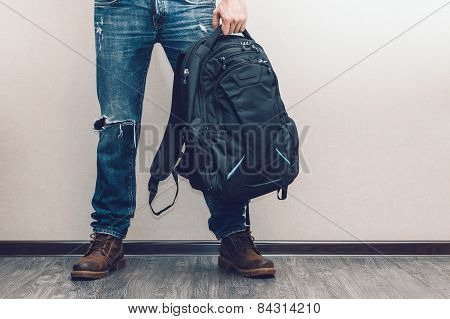 Man In Jeans With Backpack