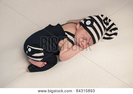Sleeping Baby Boy In Romper & Hat