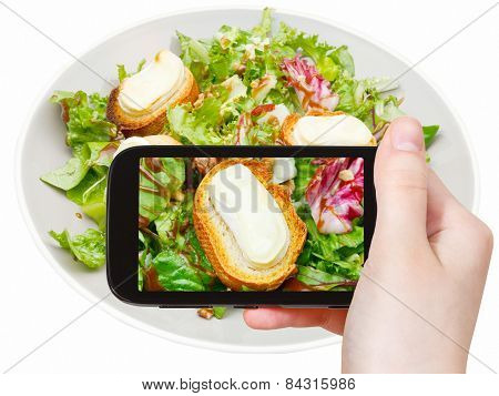 Tourist Taking Photo Of Green Salad With Cheese