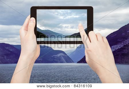 Tourist Taking Photo Of Sognefjord, Norway