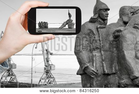 Tourist Taking Photo Of Memorial In Anadyr Town