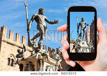 Tourist Snapping Photo Of Fountain Of Neptune