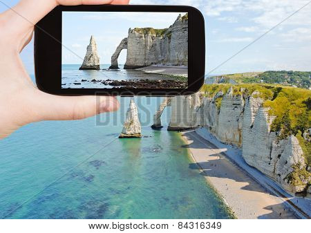 Tourist Taking Photo Of English Channel With Cliff