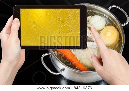 Tourist Taking Photo Of Boiling Of Chicken Broth