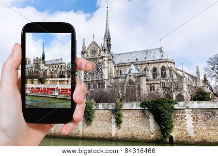 Taking Photo Of Notre Dame Paris And Tourist Boat