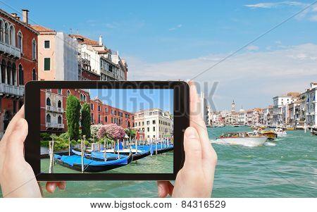 Tourist Taking Photo Of Parking Of Gondolas