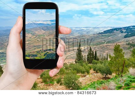 Tourist Taking Photo Of Promised Land