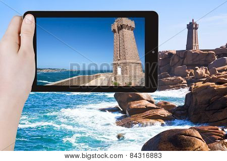 Tourist Taking Photo Of Lighthouse In Bretagne