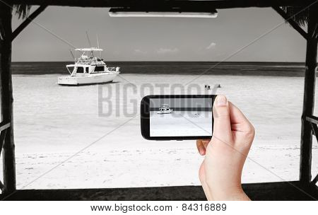 Tourist Taking Photo Of Yacht In Atlantic Ocean