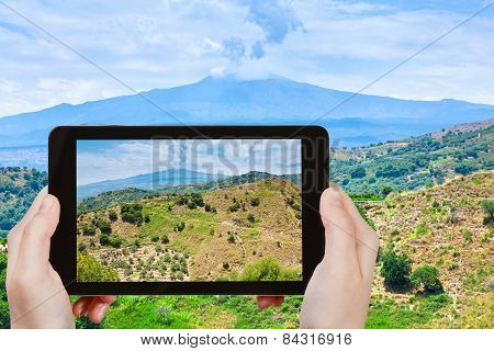 Tourist Taking Photo Of Rural Landscape With Etna