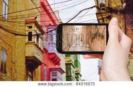 Tourist Taking Photo Of Medieval Narrow Street