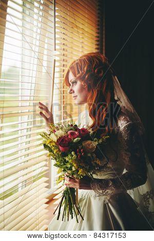 Beautiful Red Hair Bride Near Window