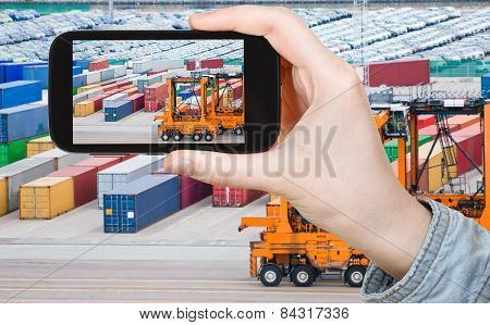 Tourist Taking Photo Of Freight Containers In Port