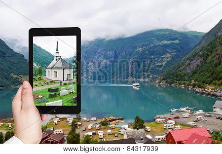 Tourist Taking Photo Of Geiranger Village