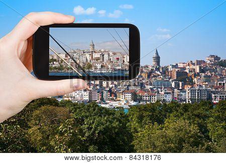 Tourist Taking Photo Of Galata Tower