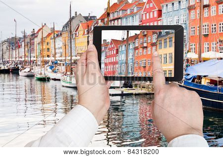 Tourist Taking Photo Of Nyhavn Harbor District