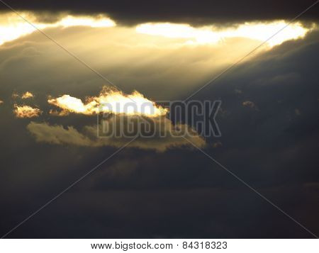 Sunlight Through The Dark Clouds