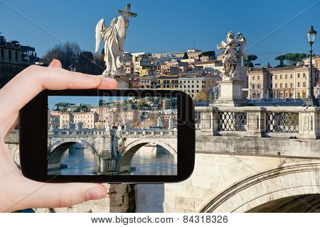 Tourist Taking Photo Of Angel Statues In Rome