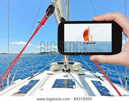 Tourist Taking Photo Of Red Yacht In Adriatic Sea
