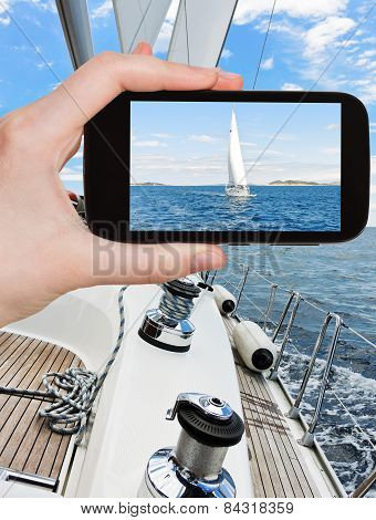 Taking Photo Of White Sail Yacht In Adriatic Sea