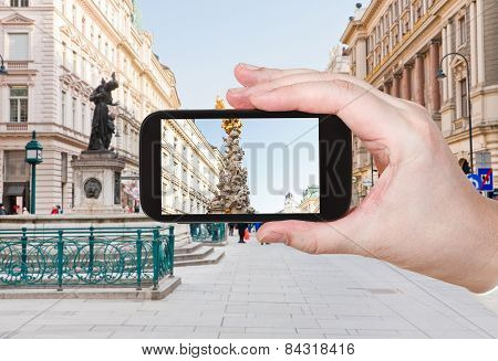 Tourist Taking Photo Of Plague Column In Vienna