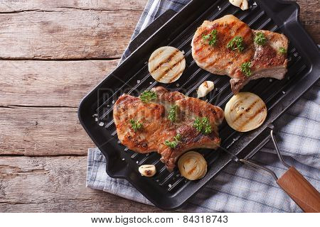 Pork Steak With Onion In A Pan Grill, Top View Horizontal